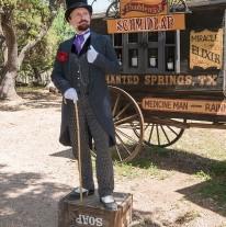 image of snake oil salesman in front of wagon full of potions